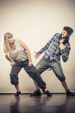 cool guy: Two modern dancers couple woman and man dancing. Urban lifestyle. Hip-hop generation.