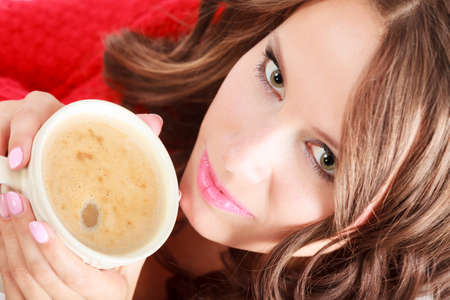 red cardigan: Attractive fall girl red autumnal sweater holding white mug with coffee warm beverage.Woman warming herself relaxing top view close up Stock Photo