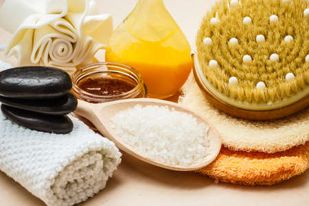 Beauty relaxation and body care. Closeup spa products some bath accessories on wooden table.