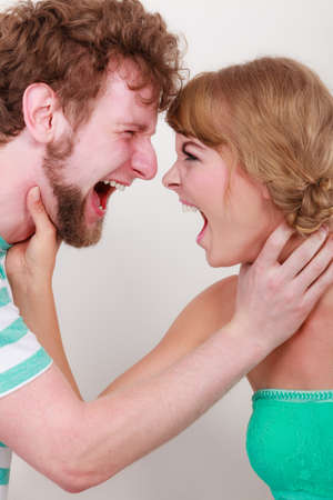 man yelling: relationship difficulties. Angry woman and man yelling at each other. Face to face. Fury couple