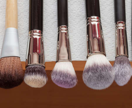 make up brushes: Beauty and makeup. Set of wet professional make up brushes after washing is drying Stock Photo