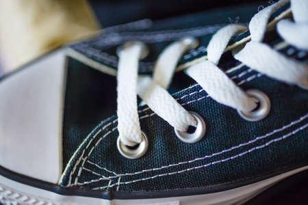 plimsoll: Closeup navy blue fashionable sneaker