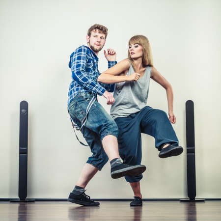 hip hop style: Two modern dancers couple woman and man dancing. Urban lifestyle. Hip-hop generation.