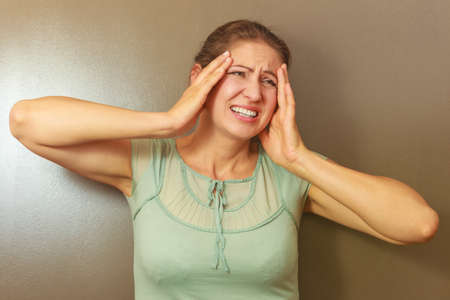 desperation: Stress and desperation concept. Middle aged stressed angry upset female woman portrait. Face emotion expression. Human on deadline reaction.