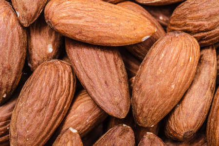 whole food: Whole food good for health. Peeled almonds closeup as background texture