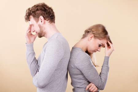 argument from love: Depression and sadness concept. Unhappy depressed couple after argument. Sad woman and disappointed man standing together. Stock Photo