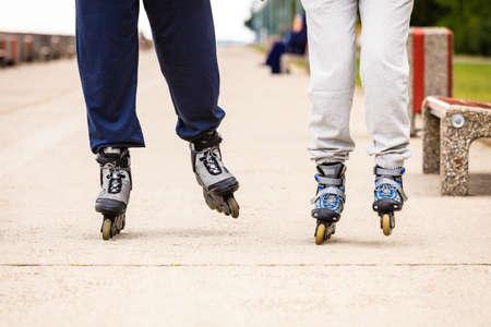 rollerskating: Active people friends rollerskating outdoor. Stock Photo