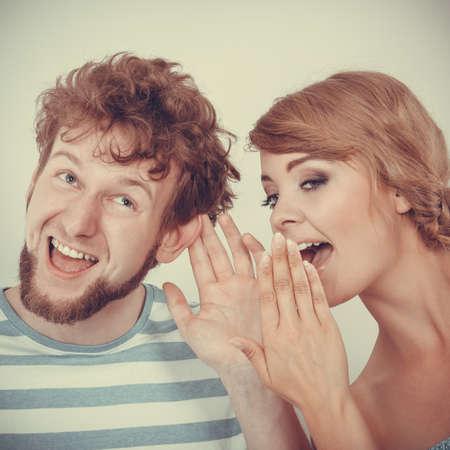 astonishment: Closeup woman telling an astonished surprised man some secrets, couple talking Stock Photo