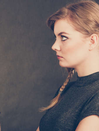 resentful: Young blonde expressive angry furious resentful woman. Stock Photo