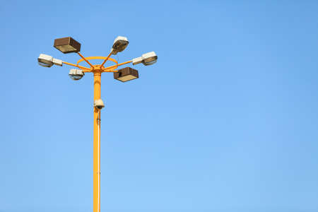 Lamp post with security camera. Pole with lights and recording device.