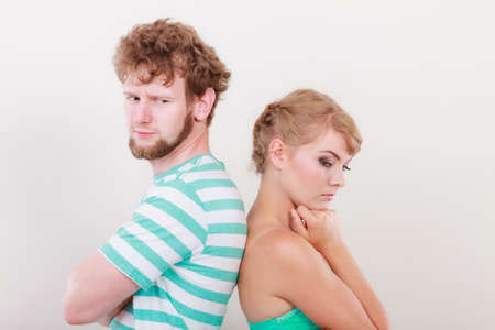 sullenly: Young couple after quarrel offended back to back, not speaking to each other Stock Photo
