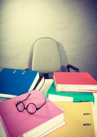 binders: Piles of colorful binders with many different documents invoice facture.