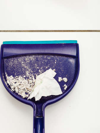 the dirt: Sweeping tool with dirt. Stock Photo