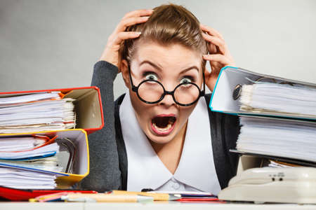 panicked: Panicked secretary at desk. Stock Photo