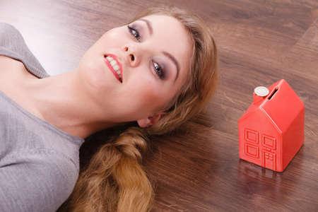 cash box: Woman lying with cash box.