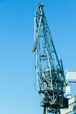 dockside: Heavy load dockside cranes in port, cargo container yard. Stock Photo