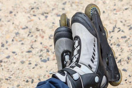 roller blade: Closeup of roller skates blades outdoor. Sport equipment. Stock Photo