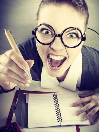 workaholic: Book keeping bureau finances corporation mental health concept. Obsessed secretary at work. Young insane lady workaholic doing paperwork. Stock Photo