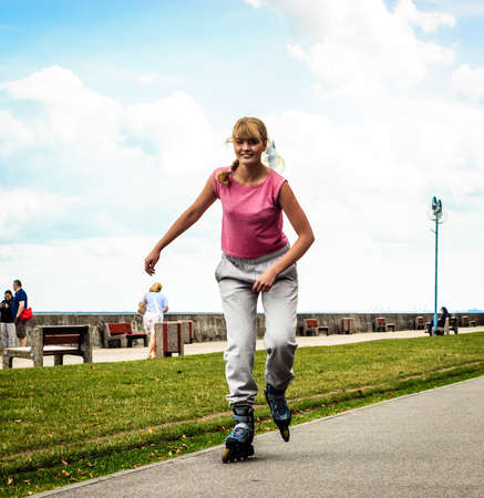 free riding: Outdoors activities sport and hobby.Wellbeing and exercising. Girl have fun riding rollerskate in park spending free time in summer.