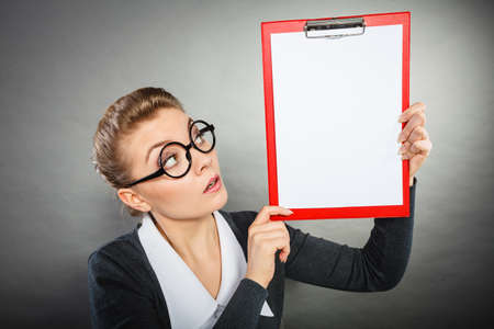 nerdy: Job work papers office concept. Nerdy girl presenting binder. Young female in glasses showing documents.