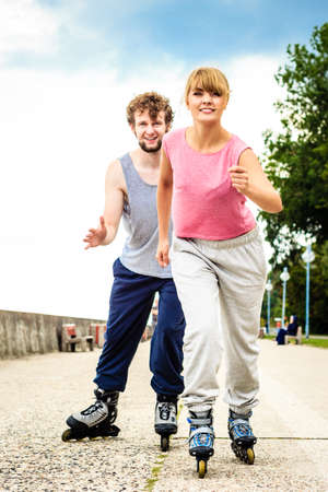 rival rivals rivalry season: Exercising and competition in sport. Healthy lifestyle and wellbeing. Summertime hobby. Young people race together on roller skate having fun.