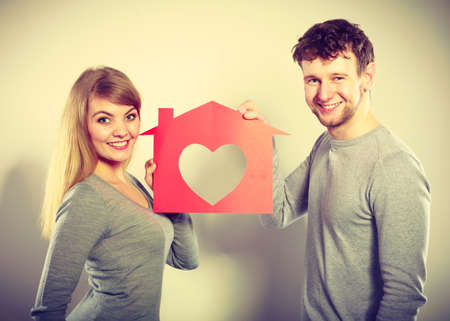 big house: Life together. First big step in relationship. Young smiling couple in love dream plan future in their new house home. Lovely enamoured marriage full of good feelings. Stock Photo