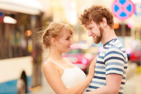 enjoying life: Romantic tourists couple walking in city street. Happy woman and man enjoying life summer vacation outdoor