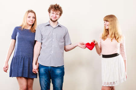 two women and one man: Relationships and feelings in triangle. Happy relationship of three people. Two women having one man. Forbidden love concept.