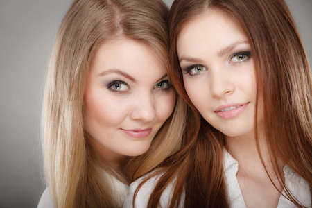 glamorous: Sisterhood and siblings love. Pretty lovely charming girls together. Two positive glamorous women sisters portrait. Stock Photo