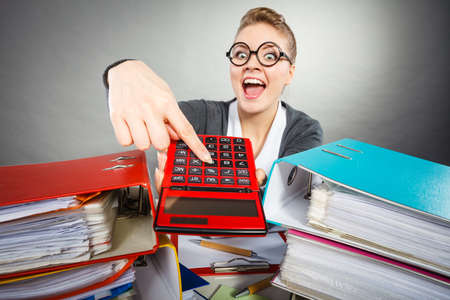bureau: Bureau calculation book keeping company concept. Workaholic secretary making gestures. Nervous office lady holding pointing at calculator.