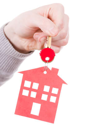 renter: Household ownership security real estate symbolism concept. Key ring with house pendant. Home symbol held by human hand.