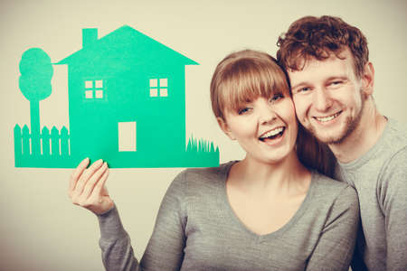 youthful: Love relationship ownership property concept. Youthful pair showing model. Adult married man woman presenting home cutout planning future. Stock Photo