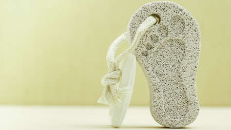 bar tool: Feet care. Pedicure accessory tool: stone pumice with foot print and bar of soap closeup Stock Photo