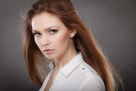 sexy businesswoman: Elegance and business fashion style. Gorgeous attractive elegant woman portrait. Sexy businesswoman with long dark hair and perfect make up.