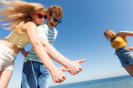 up to date: Happiness dating concept. Couple in love blonde woman bearded man enjoy date, making thumb up hand gesture outdoor, wide angle view