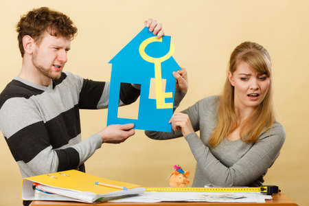 disadvantages: Advantages and disadvantages of living together. Young couple marriage arguing of new house home flat apartment place to live. Stock Photo