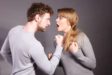 emotional couple: Negative emotions concept. People in fight. Husband and wife arguing and yelling on each other. Expressive and emotional couple having argument.