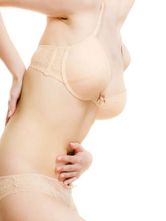 cystitis: Woman wearing lingerie with abdominal and back ache. Pain in the human body.