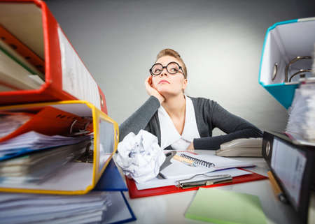 desk clerk: Paperwork job corporation lazy slow boring concept. Bored office employee at work. Female nerdy bureau clerk at desk.