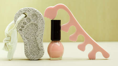 separators: Feet nails care. Pedicure accessories set tools: toe separators, varnish and stone pumice with foot print