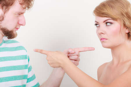 each: Conflict bad relationships concept. Two people couple pointing fingers at each other