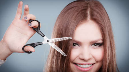 coiffure: Craziness of professional hairdresser. Hair hygiene. Girl with scissors making crazy funny face preparing herself to cutting styling new image hairdo coiffure.