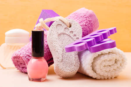 separators: Foot care and cosmetics. Pedicure accessories set tools : pumice with footprint, towel, toe separators and pink varnish