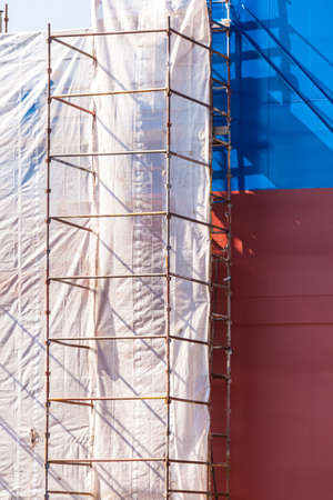 work boat: Scaffolding on boat. Ship under construction. Renovation work with protection sheet. Stock Photo