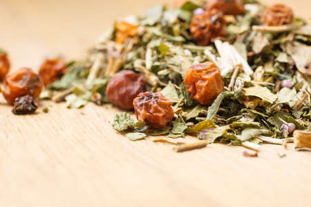 herbaceous plant: Pile of assorted natural medical dried herb leaves and fruits on wooden surface. Herbaceous plant.
