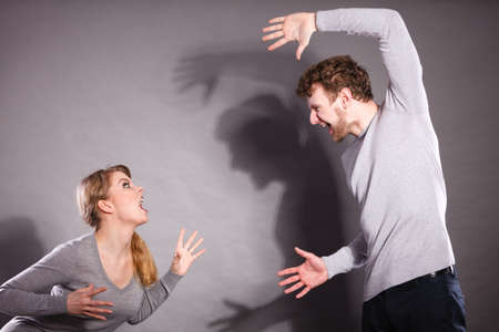 litigate: Bad relationship and divorce. Expressive young couple yelling shouting. Husband and wife having big emotional argue split quarrel. Stock Photo