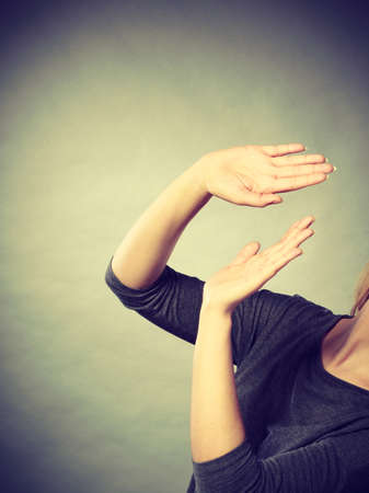 rejecting: Refusal negative threat danger communication concept. Nervous lady protecting herself. Stressed girl making defensive gesture with arms, gesturing stop with palms hands