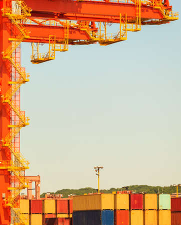 commerce and industry: Containers transported by crane. Industrial equipment in harbour transporting goods. Commerce cargo shipping maritime industry concept.