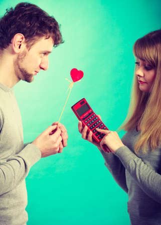 calculate: Advantages and disadvantages of relationship. Young blonde attractive lady calculate percentage provision of being girlfriend.
