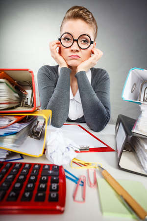 Paperwork job corporation lazy slow boring concept. Bored office employee at work. Female nerdy bureau clerk at desk.